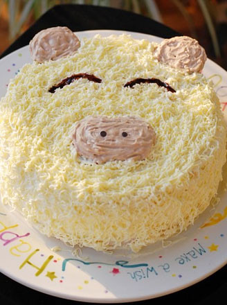 看到这样一个可爱的小猪蛋糕